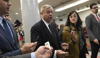 Sen. Lindsey Graham, R-S.C., is followed by reporters as they walk on Capitol Hill in Washington, Tuesday, Nov. 5, 2019. (AP Photo/Susan Walsh)