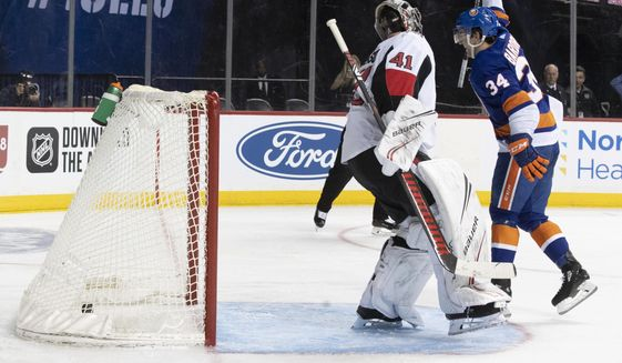 New York Islanders center Cole Bardreau (34) celebrates after scoring a penalty shot past Ottawa Senators goaltender Craig Anderson (41) during the second period of an NHL hockey game, Tuesday, Nov. 5, 2019, in New York. (AP Photo/Mary Altaffer)