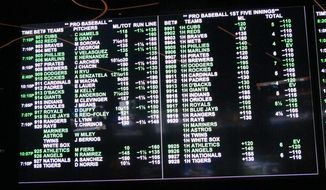 This June 28, 2019 photo shows one of the betting boards at the sports book in the Borgata casino in Atlantic City N.J. Despite a push from lawmakers favoring it, New York state is unlikely to offer mobile sports betting anytime soon, leaving much of the populous New York metropolitan region to New Jersey and Pennsylvania sports books. (AP Photo/Wayne Parry)