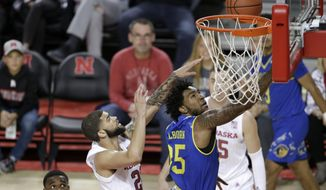 UC Riverside's George Willborn III (35) goes for a layup in front of Nebraska's Haanif Cheatham (22) during the first half of an NCAA college basketball game in Lincoln, Neb., Tuesday, Nov. 5, 2019. (AP Photo/Nati Harnik)