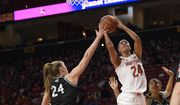 Maryland forward Stephanie Jones (24) goes to the basket as she is defended by Wagner forward Emilija Krista Grava (24) and forward Katrice Jackson (55) during the first half of an NCAA college basketball game, Tuesday, Nov. 5, 2019, in College Park, Md. (AP Photo/Nick Wass)  **FILE**