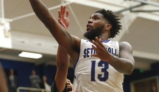 Seton Hall  guard Myles Powell (13) goes to the basket against Wagner guard Atiba Taylor during the first half of an NCAA college basketball game, Tuesday, Nov. 5, 2019, in South Orange, N.J. (AP Photo/Noah K. Murray)