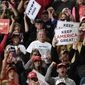 Happy fans greet President Trump at a recent campaign rally. One analyst has said that Mr. Trump's fans won't be swayed by anything. (Associated Press)