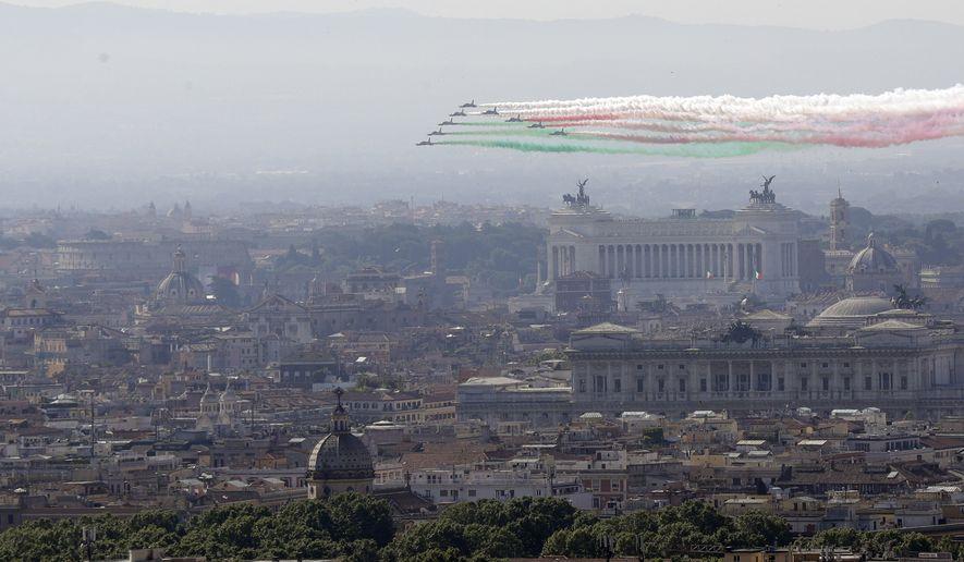 The Frecce Tricolori Italian Air Force acrobatic squad flies over Rome's skyline on the occasion of the 72nd anniversary of founding of the Italian Republic in 1946, Saturday, June 2, 2018. (AP Photo/Gregorio Borgia)