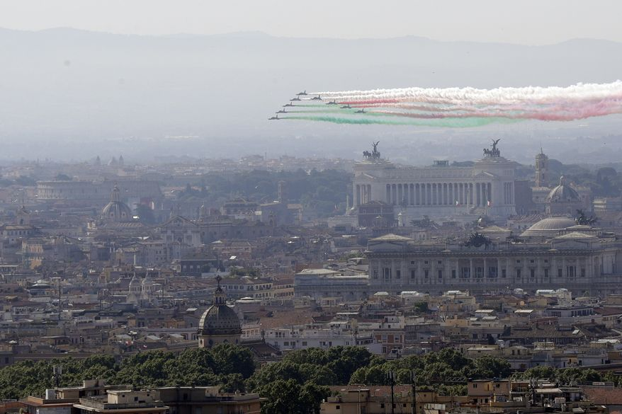 The Frecce Tricolori Italian Air Force acrobatic squad flies over Rome's skyline on the occasion of the 72nd anniversary of founding of the Italian Republic in 1946, Saturday, June 2, 2018. (AP Photo/Gregorio Borgia)