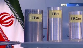 In this June 6, 2018 frame grab from the Islamic Republic Iran Broadcasting, IRIB, state-run TV, three versions of domestically-built centrifuges are shown in a live TV program from Natanz, an Iranian uranium enrichment plant, in Iran. (IRIB via AP, File) **FILE**