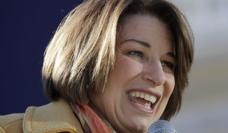 Democratic presidential candidate Sen. Amy Klobuchar, D-Minn., speaks to supporters outside the Statehouse after she filed to be listed on the New Hampshire primary ballot, Wednesday, Nov. 6, 2019, in Concord, N.H. (AP Photo/Elise Amendola)
