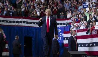 President Donald Trump arrives to speak at a campaign rally at the Monroe Civic Center, Wednesday, Nov. 6, 2019, in Monroe, La. (AP Photo/ Evan Vucci)