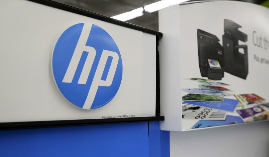 In this May 24, 2016, file photo, Hewlett-Packard products are on display at a store in North Andover, Mass. (AP Photo/Elise Amendola, File)