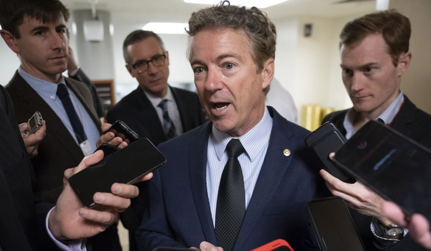 Sen. Rand Paul, R-Ky., responds to reporters at the Capitol after he threatened to reveal the name of the Ukraine whistleblower who helped initiate the impeachment inquiry against President Donald Trump by providing details of Trump's call with the Ukrainian president, in Washington, Wednesday, Nov. 6, 2019. (AP Photo/J. Scott Applewhite)