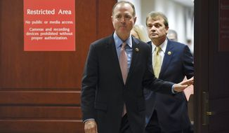 House Intelligence Committee Chairman Adam Schiff, D-Calif., followed by Rep. Mike Quigley, D-Ill., walks out to talk to reporters on Capitol Hill in Washington, Wednesday, Nov. 6, 2019, about the House impeachment inquiry. (AP Photo/Susan Walsh)