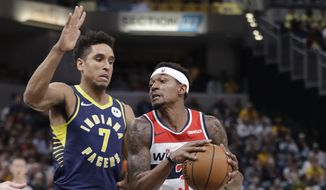 Washington Wizards guard Bradley Beal (3) goes to the basket against Indiana Pacers guard Malcolm Brogdon (7) during the first half of an NBA basketball game Wednesday, Nov. 6, 2019, in Indianapolis. (AP Photo/Darron Cummings)