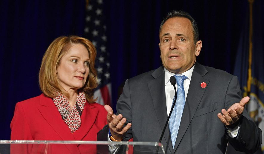 Kentucky Gov. Matt Bevin, right, with his wife Glenna, speaks to supporters gathered at the republican party celebration event in Louisville, Ky., Tuesday, Nov. 5, 2019. (AP Photo/Timothy D. Easley)