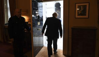Britain's Prime Minister Boris Johnson leaves 10 Downing Street on route to Buckingham Palace ahead of an audience with Queen Elizabeth II and the formal start of the General Election, in London, Wednesday, Nov. 6, 2019.(Stefan Rousseau/Pool Photo via AP)