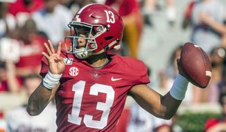 FILE - In this Sept. 7, 2019, file photo, Alabama quarterback Tua Tagovailoa (13) looks to throw during the first half of an NCAA college football game against New Mexico State, in Tuscaloosa, Ala. For the first time in college football history, there will be two games matching teams of at least 8-0 on the same day, according to ESPN Facts and Info. In Tuscaloosa, Alabama, LSU and the Crimson Tide will play the first regular-season game matching AP Nos. 1 and 2 since 2011 _ when No. 1 LSU beat No. 2 Alabama 9-6 in overtime. (AP Photo/Vasha Hunt, File)
