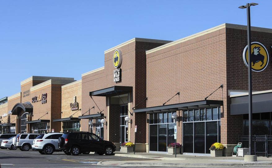 The Buffalo Wild Wings restaurant in Naperville, a suburb of Chicago on Tuesday, Nov. 5, 2019, where black customers said they were asked to move to a different table after a regular customer told managers he didn't want to sit near them. (AP Photo/Teresa Crawford)