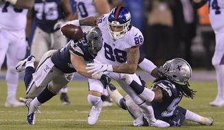 New York Giants tight end Evan Engram (88) is tackled by Dallas Cowboys outside linebacker Sean Lee, left, and middle linebacker Jaylon Smith (54) during the third quarter of an NFL football game, Monday, Nov. 4, 2019, in East Rutherford, N.J. (AP Photo/Bill Kostroun)