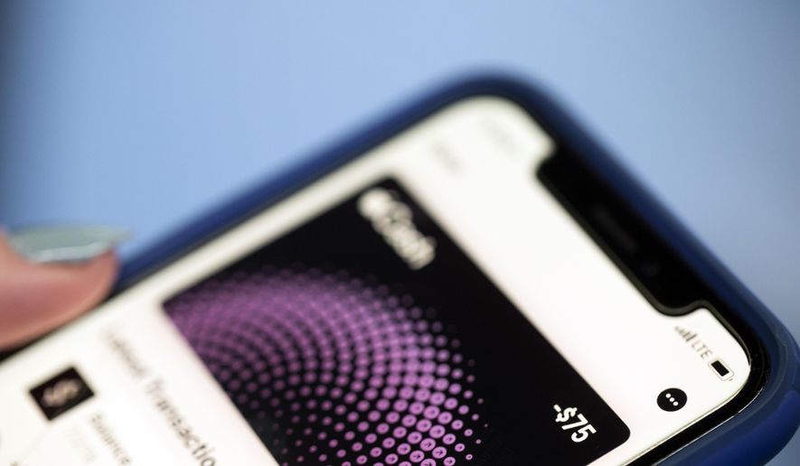 This Tuesday, Oct. 8, 2019, photo shows the Apple Pay app on an iPhone in New York. Experts warn that digital wallet services like Apple Cash and Venmo are prime targets for scammers. (AP Photo/Jenny Kane)