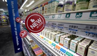 FILE - In this May 30, 2019, file photo, signs advertise new products available inside a CVS store with the new HealthHUB in Spring, Texas. CVS Health reports financial results Wednesday, Nov. 6. (AP Photo/David J. Phillip, File)
