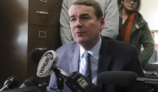 Democratic presidential candidate Sen. Michael Bennet, D-Colo., speaks to the media in the New Hampshire secretary of state's office on Wednesday, Nov. 6, 2019, in Concord, N.H., after filing to be on the state's first-in-the-nation presidential primary ballot. (AP Photo/Holly Ramer)