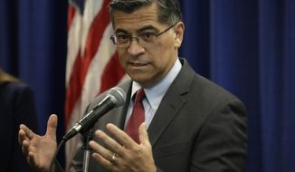 California Attorney General Xavier Becerra gestures while speaking at a media conference Wednesday, Nov. 6, 2019, in San Francisco. Becerra disclosed an ongoing probe into Facebook privacy practices as investigators sought a court's help in getting documents and answers from Facebook. The California probe, one of many legal inquiries into Facebook, began as a response to the Cambridge Analytica scandal and grew into an investigation into whether Facebook has misrepresented its privacy practices, deceived users and broken California law.(AP Photo/Ben Margot) **FILE**