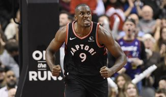 Toronto Raptors forward Serge Ibaka (9) reacts after his dunk against the Sacramento Kings during the second half of an NBA basketball game Wednesday, Nov. 6, 2019, in Toronto. (Nathan Denette/The Canadian Press via AP)