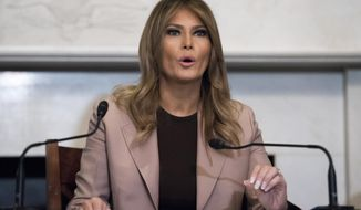 """FILE - In this Wednesday, Oct. 23, 2019 file photo first lady Melania Trump participates in a roundtable discussion on the opioid crisis, on Capitol Hill in Washington. The first lady is to make a planned stop Wednesday, Nov. 6, 2019, at Boston Medical Center, in Boston, as part of her """"Be Best"""" initiative. (AP Photo/Cliff Owen, File)"""