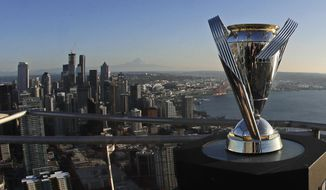 The MLS Cup trophy is displayed on the roof of the Space Needle, Tuesday, Nov. 5, 2019, in Seattle. The Seattle Sounders are scheduled to face Toronto FC on Sunday in the MLS Cup soccer match at CenturyLink Field in Seattle, the third time the two teams have met for the MLS championship. (AP Photo/Ted S. Warren)