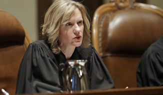 In this Jan. 22, 2019 photo, Justice Debra Stephens speaks from the bench during a Washington Supreme Court hearing in Olympia, Wash. On Wednesday, Nov. 6, 2019, Stephens was elected by her fellow members of the state Supreme Court to be the new chief justice. She will replace current Chief Justice Mary Fairhurst, who announced last month she will retire from the high court in January to focus on her health as she fights a third bout of cancer. (AP Photo/Ted S. Warren)
