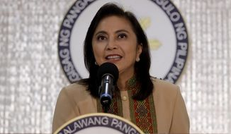 """Philippine Vice-president Leonor """"Leni"""" Robredo delivers her statement Wednesday, Nov. 6, 2019, in suburban Quezon city northeast of Manila, Philippines. Robredo has accepted an offer by President Rodrigo Duterte for her to play a lead role in his deadly crackdown against illegal drugs even though she's been warned it could be a political ploy to destroy her. (AP Photo/Bullit Marquez)"""