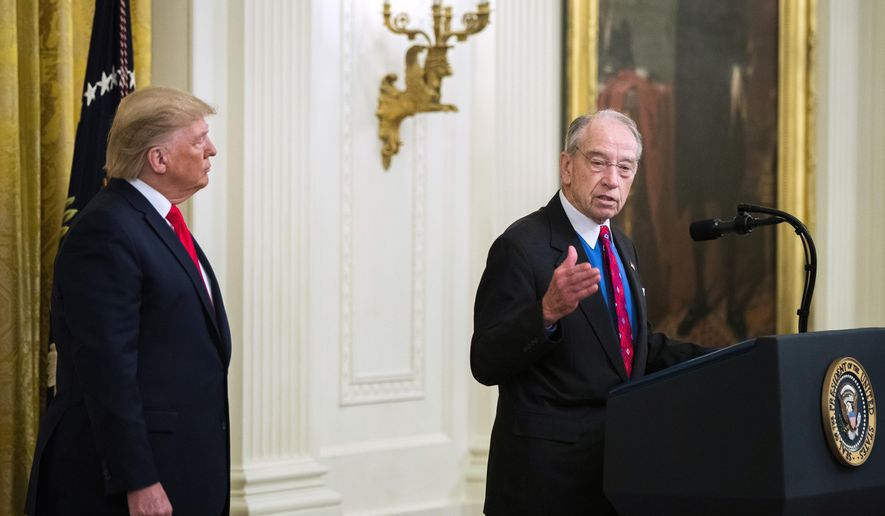 President Donald Trump listens to Sen. Chuck Grassley, R-Iowa, speak during a ceremony in the East Room of the White House where Trump spoke about his judicial appointments, Wednesday, Nov. 6, 2019, in Washington. (AP Photo/Manuel Balce Ceneta) **FILE**
