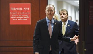 House Intelligence Committee Chairman Adam Schiff, D-Calif., followed by Rep. Mike Quigley, D-Ill., walks out to talk to reporters on Capitol Hill in Washington, Wednesday, Nov. 6, 2019, about the House impeachment inquiry. (AP Photo/Susan Walsh) ** FILE **