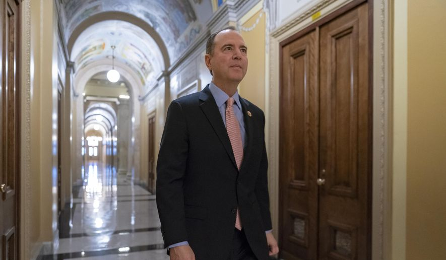 Rep. Adam Schiff, chairman of the House Intelligence Committee, walks to a secure area at the Capitol to interview a witness in the House impeachment inquiry on President Donald Trump's efforts to press Ukraine to investigate his political rivals, in Washington, Wednesday, Nov. 6, 2019.  (AP Photo/J. Scott Applewhite)