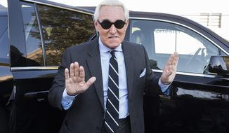 Roger Stone arrives at Federal Court for the second day of jury selection for his federal trial, in Washington, Wednesday, Nov. 6, 2019. (AP Photo/Cliff Owen)