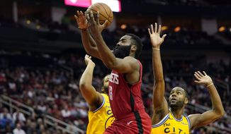 Houston Rockets' James Harden (13) goes up for a shot as Golden State Warriors' Alec Burks (8) and Omari Spellman defend during the second half of an NBA basketball game Wednesday, Nov. 6, 2019, in Houston. The Rockets won 129-112. (AP Photo/David J. Phillip)