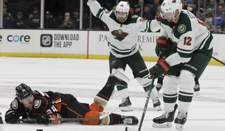 Anaheim Ducks center Sam Steel, left, is tripped by Minnesota Wild center Eric Staal during the second period of an NHL hockey game in Anaheim, Calif., Tuesday, Nov. 5, 2019. (AP Photo/Chris Carlson)