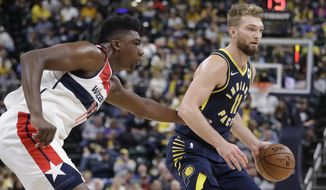 Indiana Pacers forward Domantas Sabonis (11) is defended by Washington Wizards center Thomas Bryant (13) during the second half of an NBA basketball game Wednesday, Nov. 6, 2019, in Indianapolis. Indiana won 121-106. (AP Photo/Darron Cummings)