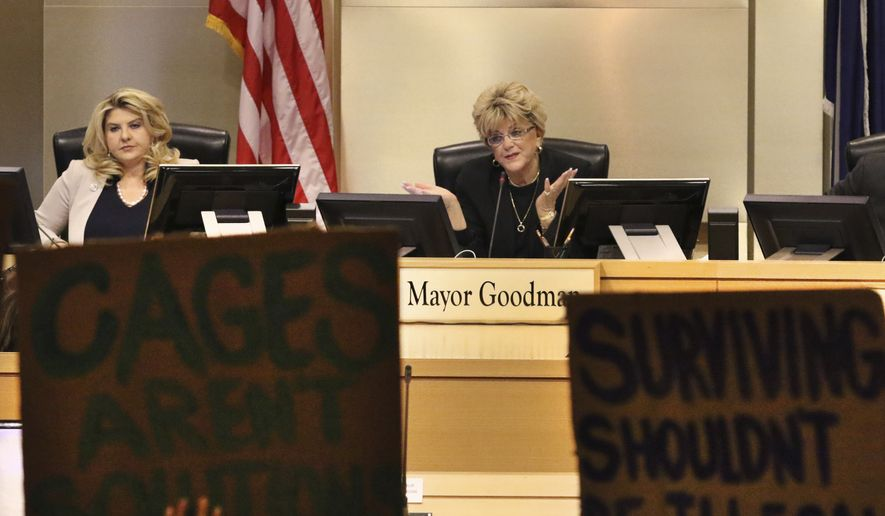 Council member Michele Fiore, left, listens as Las Vegas Mayor Carolyn Goodman speaks during the council meeting where the city council was considering a ban on homeless camping on Wednesday, Nov. 6, 2019, in Las Vegas. Officials passed a law Wednesday making it illegal for the homeless to sleep on streets when beds are available at established shelters. (Bizuayehu Tesfaye /Las Vegas Review-Journal via AP)