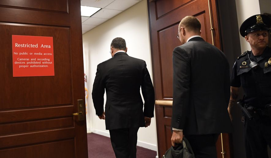 Former National Security Council Director for European Affairs Lt. Col. Alexander Vindman, center, arrives to review his testimony before a closed-door interview in the impeachment inquiry on President Donald Trump's efforts to press Ukraine to investigate his political rival, Joe Biden, at the Capitol in Washington, Thursday, Nov. 7, 2019. (AP Photo/Susan Walsh)
