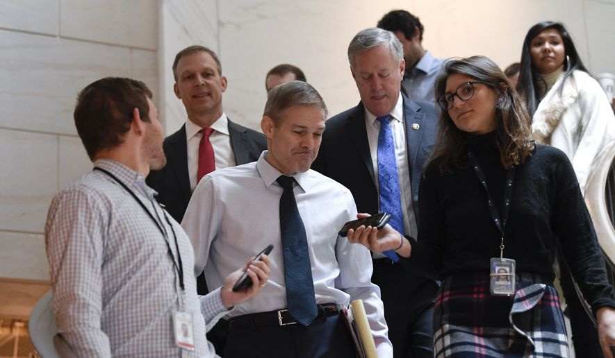 Rep. Jim Jordan, R-Ohio, center, Rep. Scott Perry, R-Pa., second from left, and Rep. Mark Meadows, R-N.C., fourth from left, are surrounded by reporters on Capitol Hill in Washington, Thursday, Nov. 7, 2019, as they head to a closed-door interview in the impeachment inquiry on President Donald Trump's efforts to press Ukraine to investigate his political rival, Joe Biden. (AP Photo/Susan Walsh)