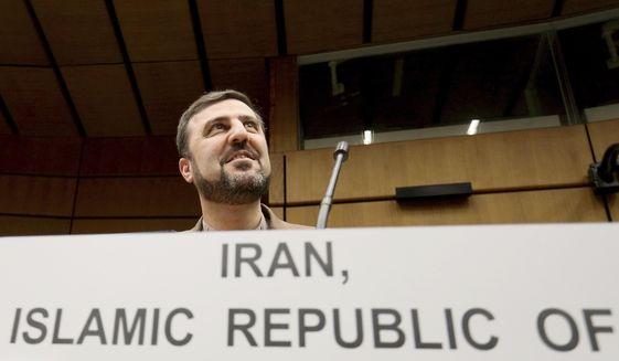 Iran's Ambassador to the International Atomic Energy Agency, IAEA, Gharib Abadi, waits for the start of the IAEA board of governors meeting at the International Center in Vienna, Austria, Thursday, Nov. 7, 2019. (AP Photo/Ronald Zak)