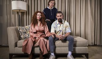 """This Oct. 5, 2019 photo shows, from left, director Alma Har'el, actor Lucas Hedges and actor Shia LaBeouf posing for a portrait to promote their film """"Honey Boy"""" during the London Film Festival. (Photo by Joel C Ryan/Invision/AP)"""