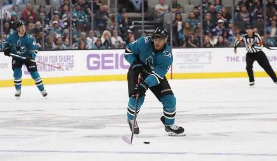San Jose Sharks left wing Evander Kane (9) looks to pass ...