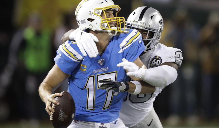 Los Angeles Chargers quarterback Philip Rivers (17) is sacked by Oakland Raiders defensive end Clelin Ferrell during the second half of an NFL football game in Oakland, Calif., Thursday, Nov. 7, 2019. (AP Photo/Ben Margot)