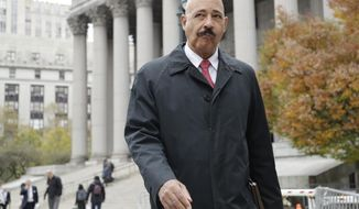 Ted Wells, Jr., the lead attorney for Exxon, leaves Manhattan Supreme court Thursday, Nov. 7, 2019, in New York. New York's attorney general is accusing Exxon Mobil of misleading investors about how profitable the company will remain as governments impose stricter regulations to combat global warming. (AP Photo/Frank Franklin II)