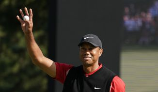 Tiger Woods of the United States reacts after his putt on the 18th hole during the final round of the Zozo Championship PGA Tour at the Accordia Golf Narashino country club in Inzai, east of Tokyo, Japan, Monday, Oct. 28, 2019. (AP Photo/Lee Jin-man)  **FILE**