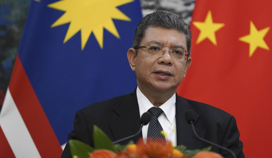 FILE - In this Sept. 12, 2019, file photo, Malaysian Foreign Minister Saifuddin Abdullah speaks during a press conference at the end of a meeting with Chinese Foreign Minister Wang Yi at the Diaoyutai State Guesthouse in Beijing. Malaysia has rejected a U.S. plan to host an Asia-Pacific trade summit in January, after Chile scrapped the November meeting over violent anti-government protests. (Andrea Verdelli/Pool Photo via AP, FIle)