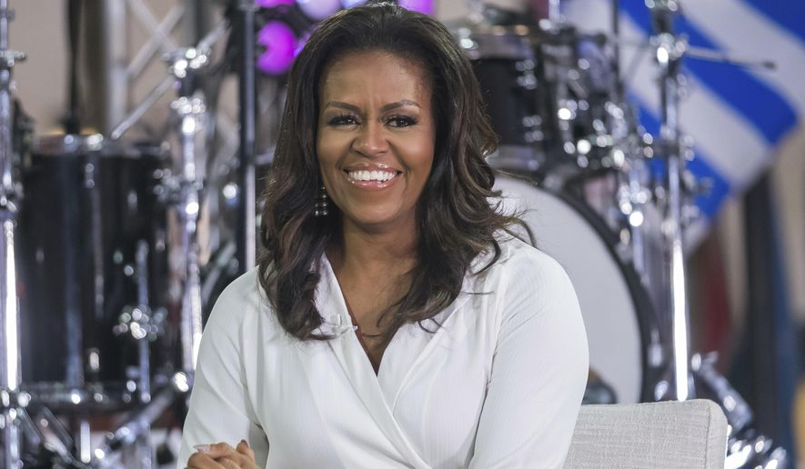 """In this Oct. 11, 2018, file photo, Michelle Obama participates in the International Day of the Girl on NBC's """"Today"""" show in New York. (Photo by Charles Sykes/Invision/AP, File)"""