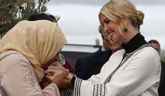 Farmer Aicha Bourkib kisses Ivanka Trump's hand, the daughter and senior adviser to President Donald Trump, in the province of Sidi Kacem, Morocco, Thursday, Nov. 7, 2019, as Ivanka Trump tours an olive grove collective where local women farmers are benefitting from changes allowing them to inherit land. (AP Photo/Jacquelyn Martin)