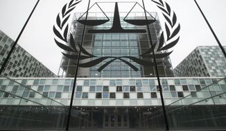 View of the International Criminal Court, or ICC, where Congolese militia commander Bosco Ntaganda is scheduled to hear the sentence in his trial in The Hague, Netherlands, Thursday, Nov. 7, 2019. The ICC is delivering the sentence on Ntaganda, accused of overseeing the slaughter of civilians by his soldiers in the Democratic Republic of Congo in 2002 and 2003. (AP Photo/Peter Dejong)